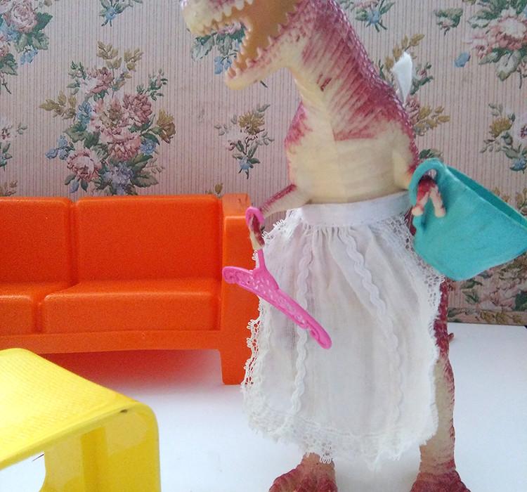 Photo of a Illustration of a Tyrannosaurus rex doing housework