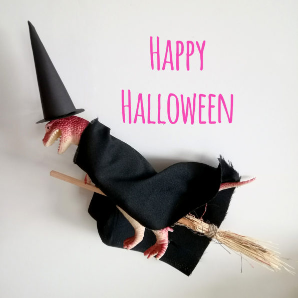 T-rex dressed like a witch, fliying on a broom, happy halloween